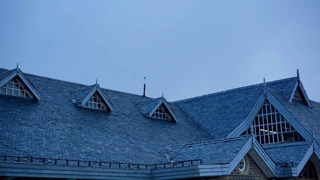 Large roof with asphalt shingles.